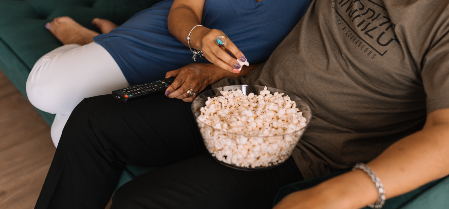 couple on couch with popcorn
